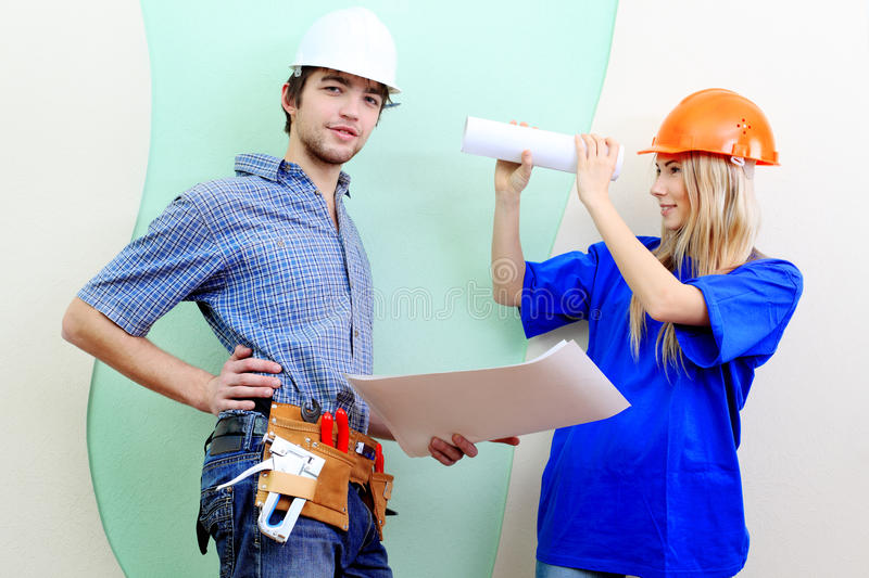 Builders. Happy family making repairs at their new home stock images