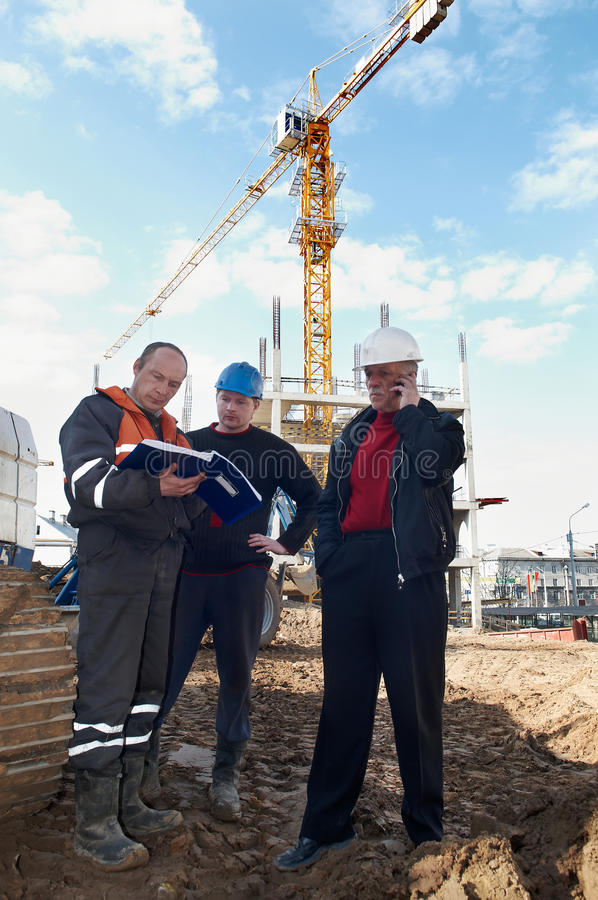 Builders at construction site stock images