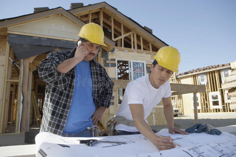 Download Builders At Construction Site Stock Photo - Image: 29655366