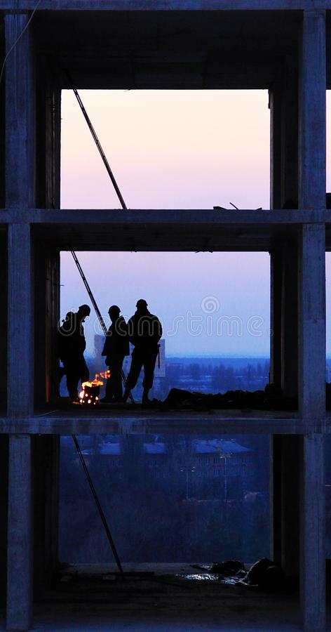 Builders are heated by the fire stock photo