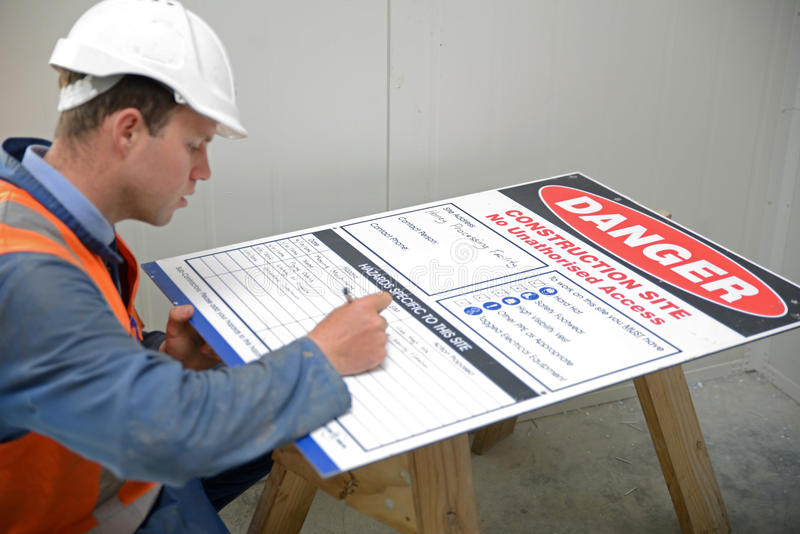 Builders look out for safety stock image
