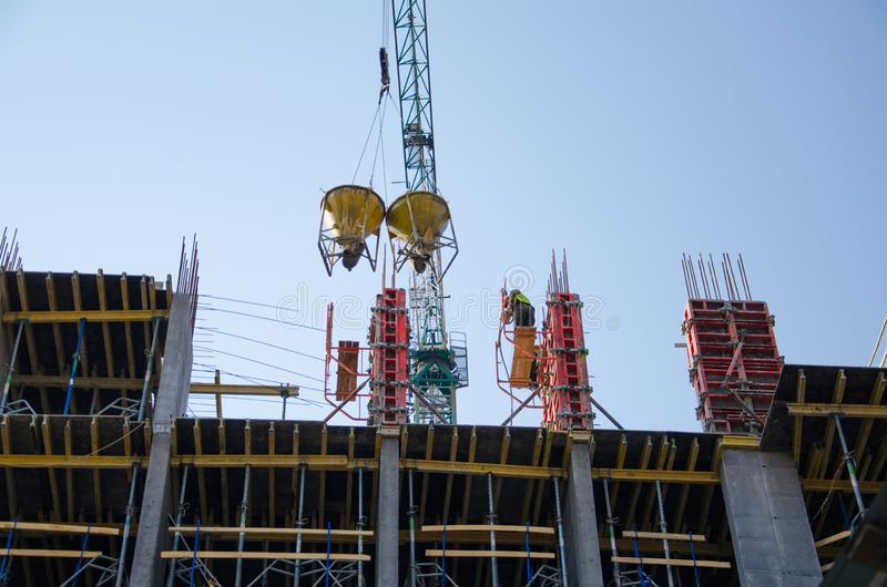 Builders are putting a monolithic formwork stock images