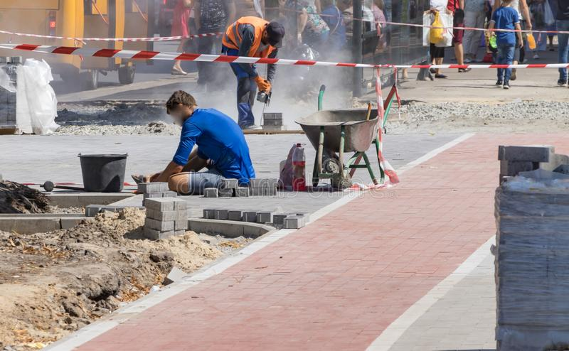 Builders repair the pavement with industrial equipment royalty free stock photos