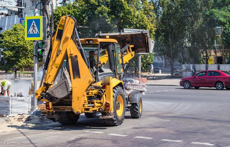 Builders repair the pavement with industrial equipment royalty free stock images