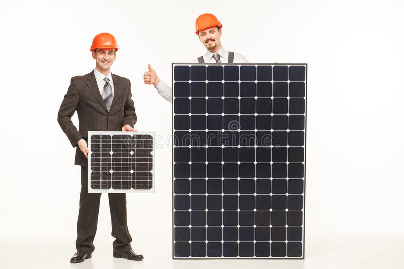 Builders with solar panels white background stock photos