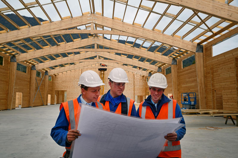 Builders study the plan royalty free stock photos