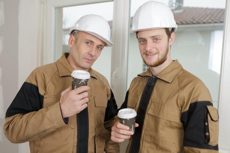 Builders taking coffee break. Builders taking a coffee break royalty free stock photos