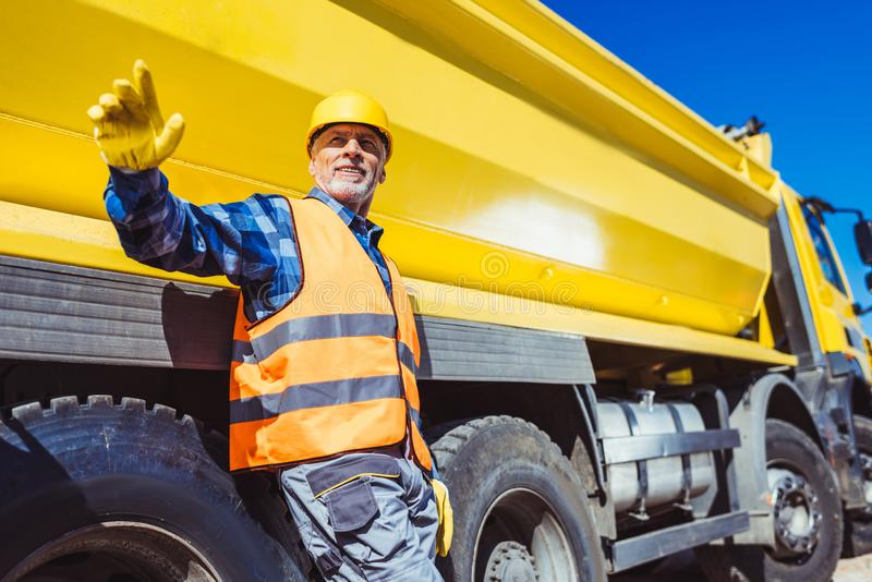 Builders and tip truck stock image