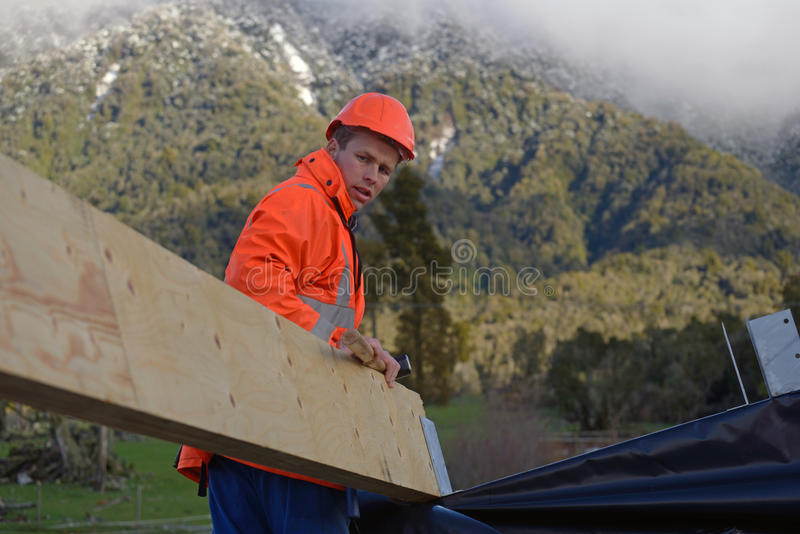 Builders on top stock photos