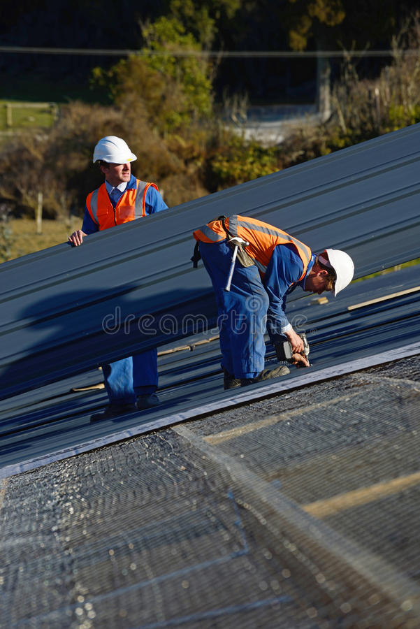Builders on top royalty free stock photography