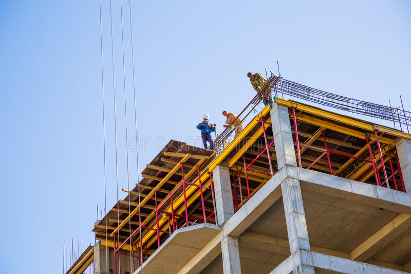 Builders on a top stock photo
