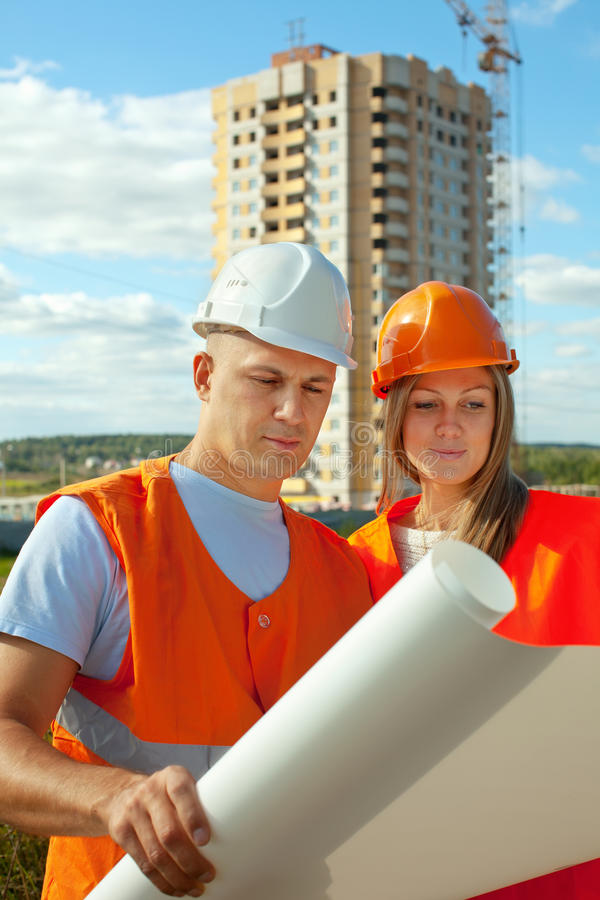 Download Builders Works At Construction Site Stock Photo - Image: 26567360