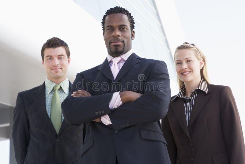 buildin business outdoors people standing three στοκ εικόνα