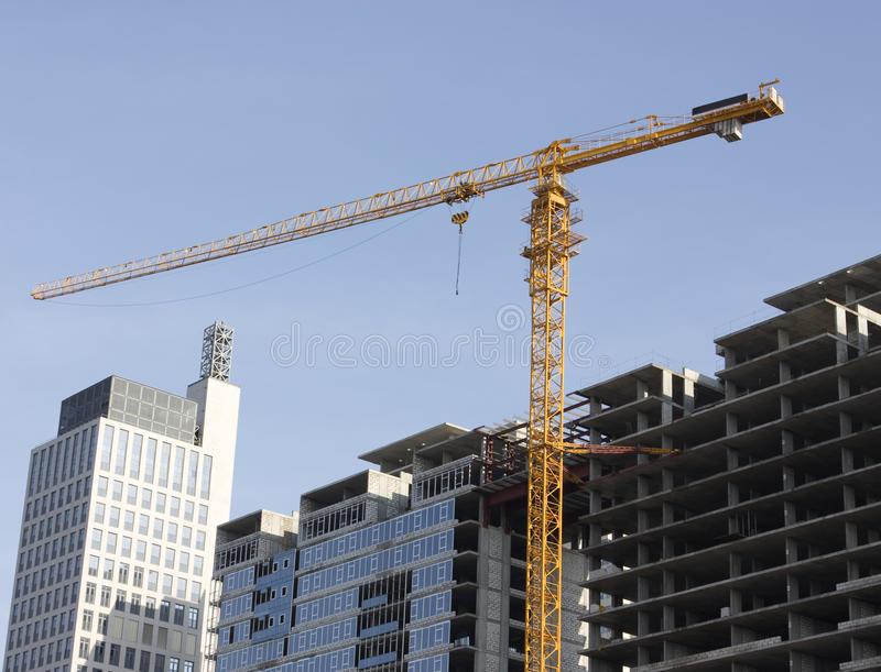 Building. On the image there is hoisting crane and unfinished house stock photos