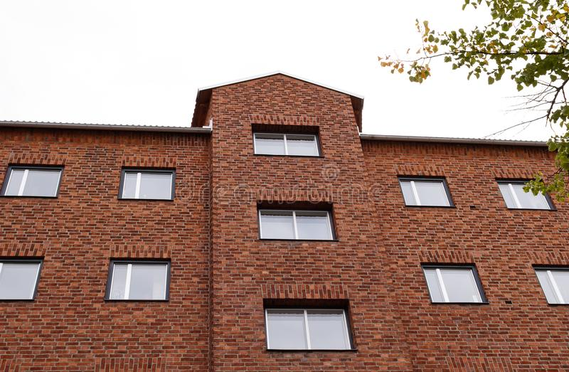 Building accent. Red brick wall with building accent royalty free stock photos