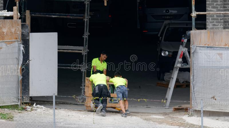 Building activities update 176 at 47 Beane St. Gosford. January 2019. Gosford, New South Wales, Australia - January 31, 2019: Construction workers receiving royalty free stock images