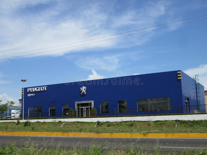 Building Agency Peugeot cars, logo. Building Cars Peugeot distributor Agency with the characteristic blue color and logo, this building is located in Puerto royalty free stock photos