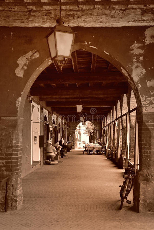 Building archway in Italy. Aged building archway located in Zibello, Parma province, Italy royalty free stock photos