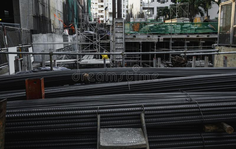 Building armature in the warehouse of metallurgical products or on construction site. Stack of heavy metal reinforcement stock image