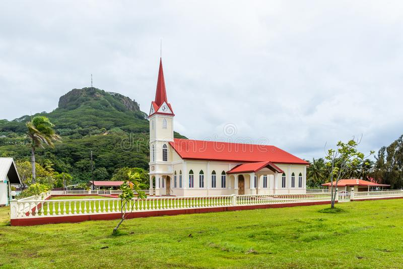 The building on the background of a mountain landscape, Raiatea island, French Polynesia. Copy space for text.  stock photo