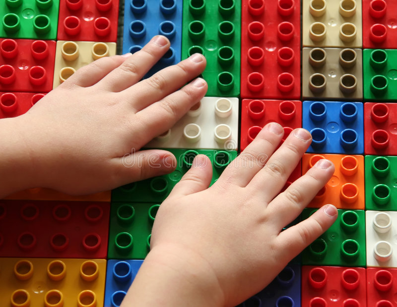 Building blocks 4. Hands of a child building blocks, lining them up in a row. Useful for a building concept or exploring concepts stock images