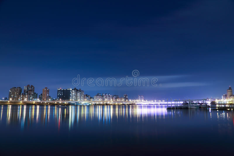 Building On Blue River During Night Time Free Public Domain Cc0 Image