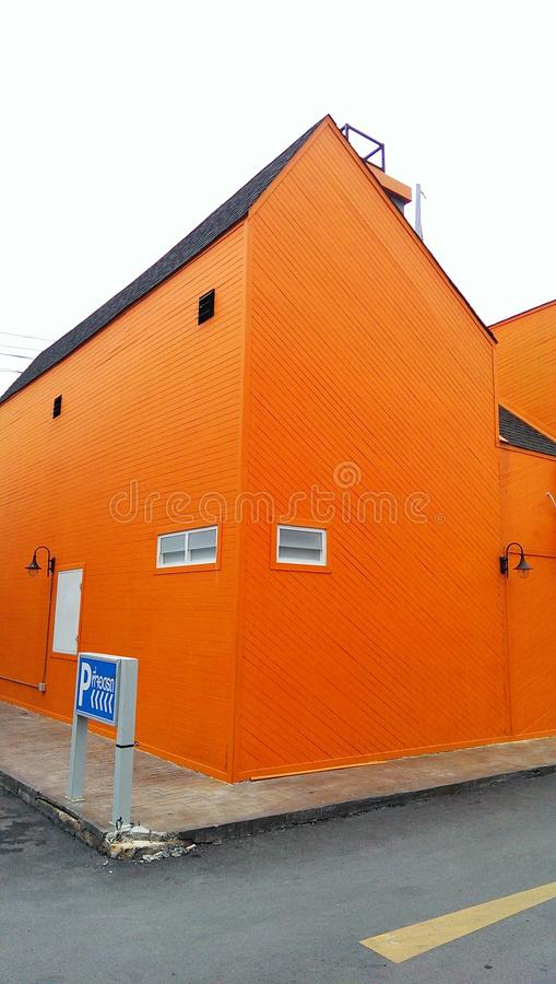 Building bright orange street wall royalty free stock photo