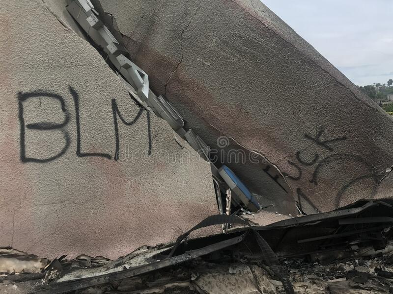 Building burned by after protest march in La Mesa, California stock images