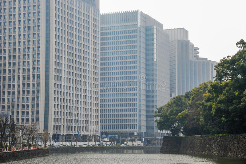 Building in business area side of canel in the cloudy day. Tokyo stock image