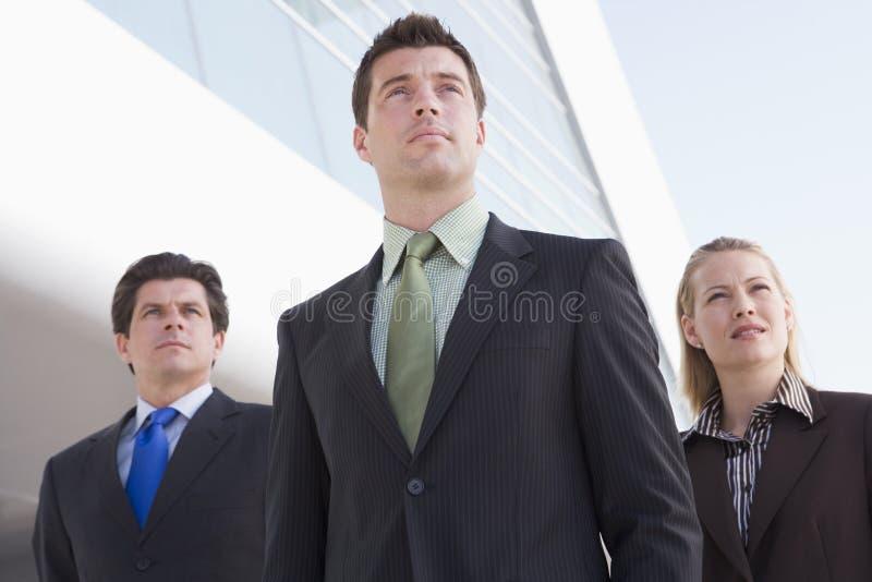 building businesspeople outdoors standing three στοκ φωτογραφίες