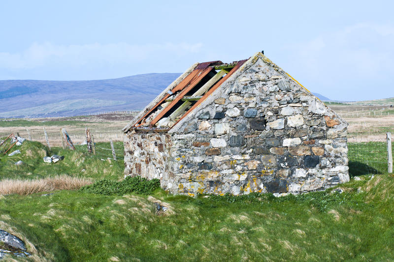 Building, Byre, Barn, Abandoned. An abandoned stone built byre or barn with only part of the original corrugated iron roof remaing. Cladach Chirceboist, North stock images