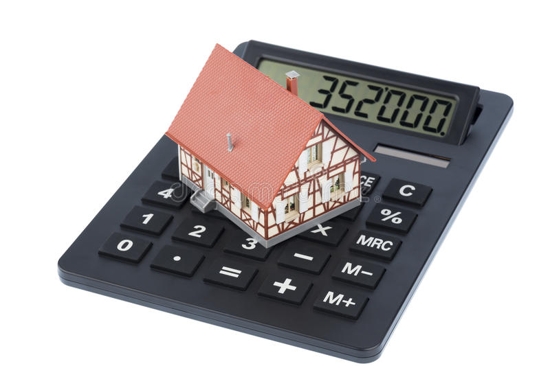 Building on calculator. House on a calculator, photo icon for house purchase, costs and savings stock photography