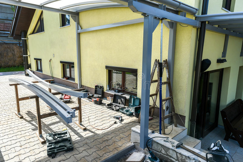 Building a canopies on a residential house royalty free stock image