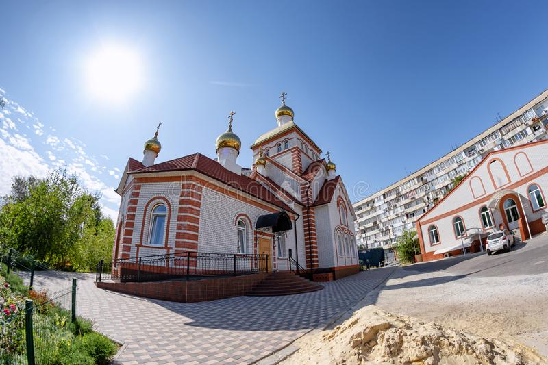 The building of the Church of all Russian saints of white brick with gold domes royalty free stock photo