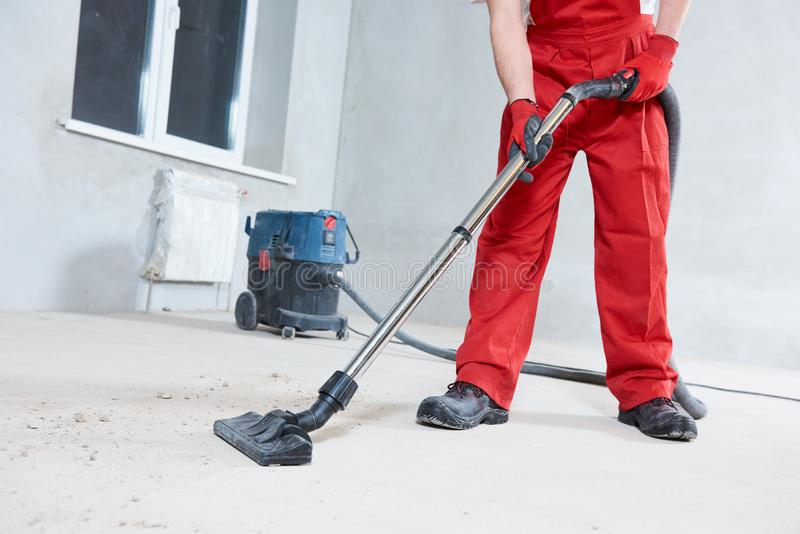 Building cleaning service. dust removal with vacuum cleaner stock image