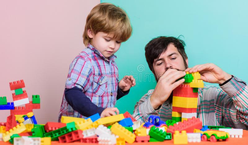 Building with colorful constructor. love. child development. father and son play game. small boy with dad playing. Together. happy family leisure. help and royalty free stock photography