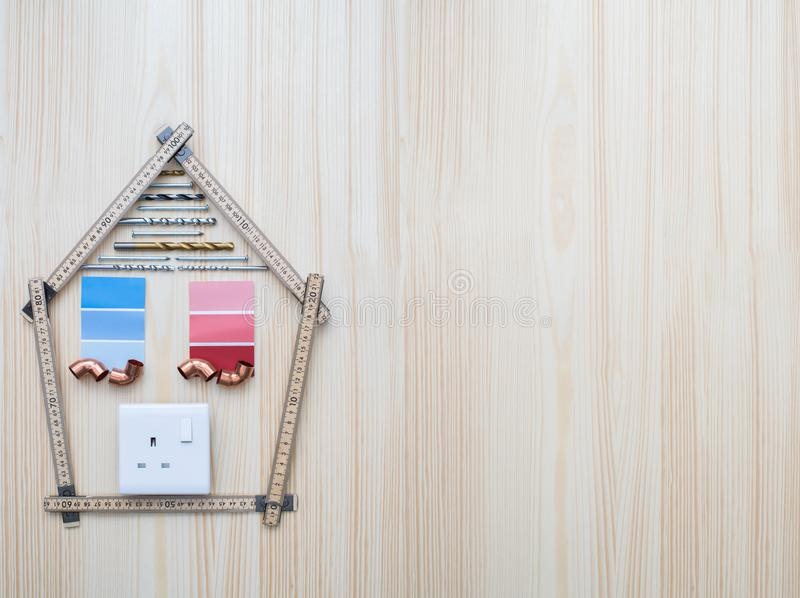 Building Components Arranged In Shape Of House On Wooden Background stock images