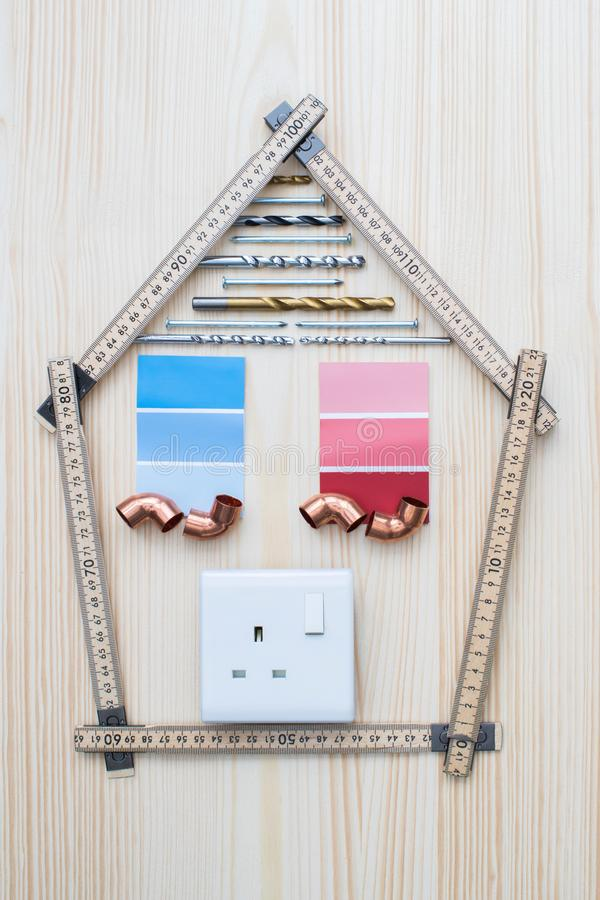 Building Components Arranged In Shape Of House On Wooden Background royalty free stock images