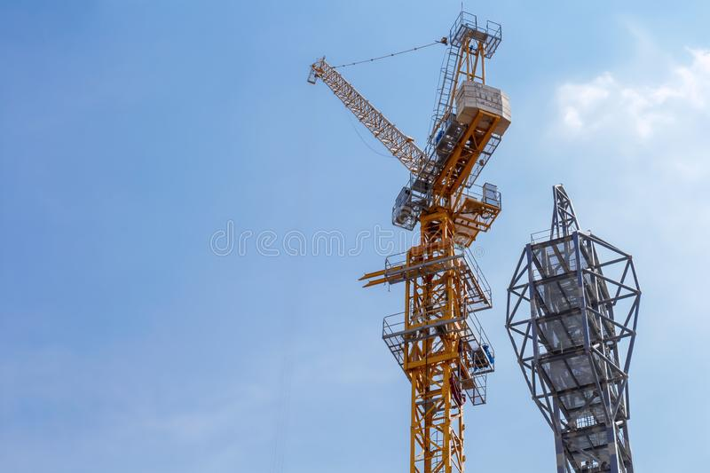 Building construction of modern real estate home with tower cranes under construction working site in the urban on sky background. The modern building with royalty free stock photo