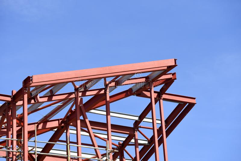 Building construction in progress. Red primer painted steelwork royalty free stock photo