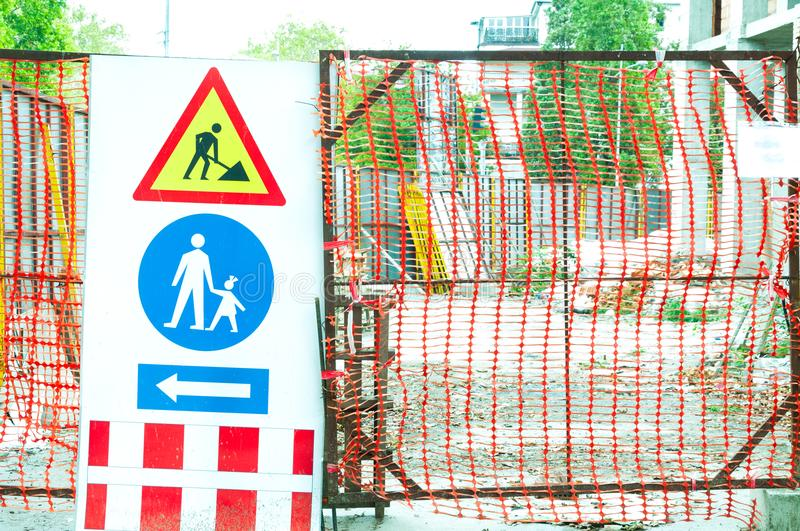 Building construction site gate with warning signs for caution. Building construction site gate with warning signs for caution royalty free stock photography