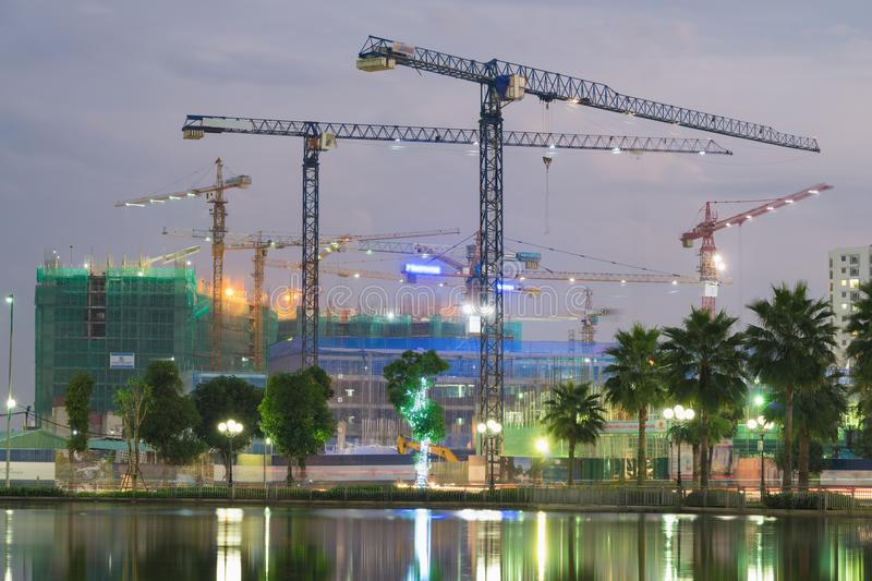 Building construction site by a lake in Hanoi, Vietnam.  stock photos