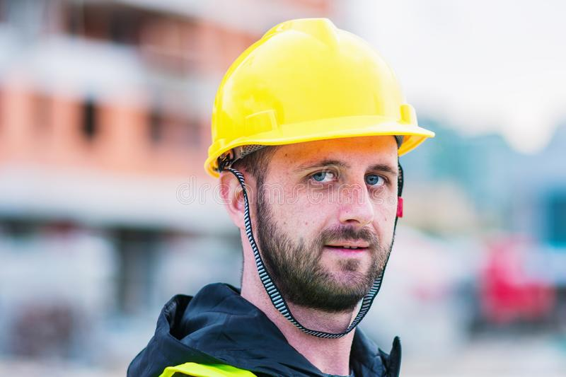 Building construction worker engineer posing stock photo