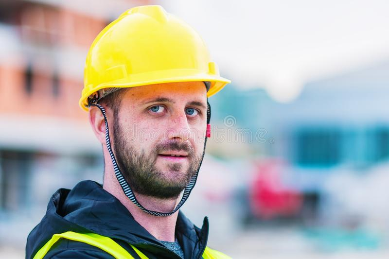 Building construction worker engineer posing royalty free stock photo