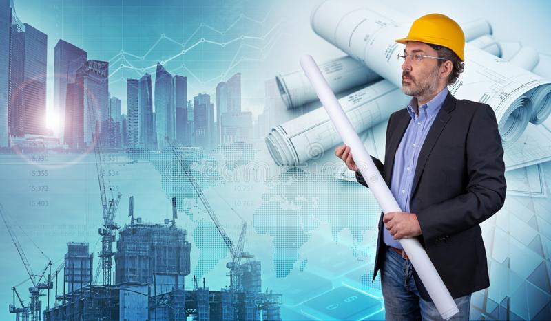 Building contractor holding blueprint in a cityscape background royalty free stock image