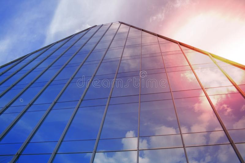 Building a corporate office business low angle. Glass and steel Art Nouveau business district skyscraper. Technological commercial stock image