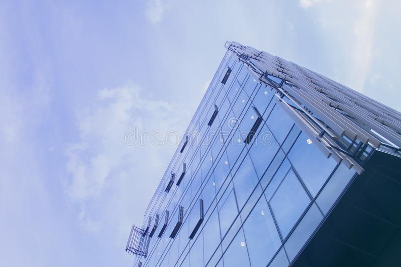 Building a corporate office business low angle. Glass and steel Art Nouveau business district skyscraper. Technological commercial royalty free stock image