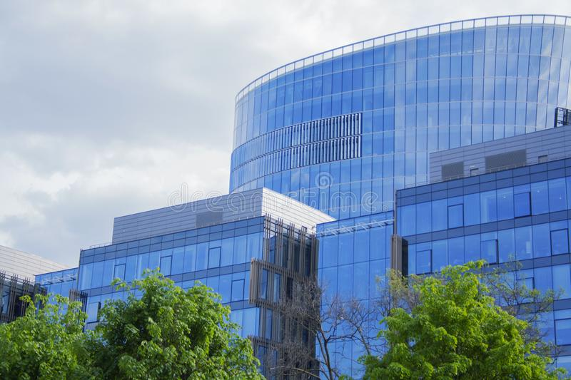 Building a corporate office business low angle. Glass and steel Art Nouveau business district skyscraper. Technological commercial royalty free stock images
