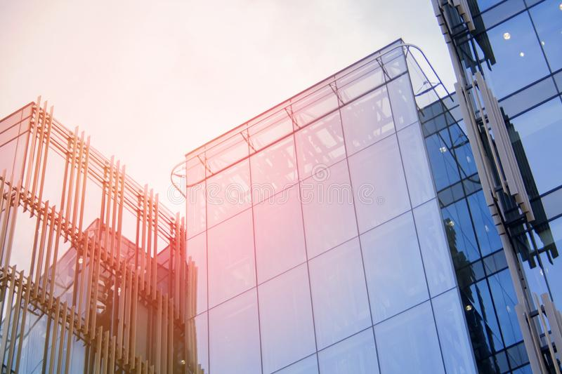 Building a corporate office business low angle. Glass and steel Art Nouveau business district skyscraper. Technological commercial royalty free stock photography