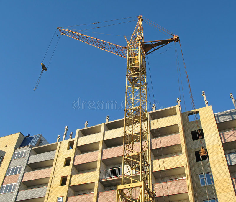 Building crane - 6. Building crane on construction vein high-rise building royalty free stock image